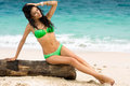 Young lady in bikini sunbathing on beach Royalty Free Stock Photo