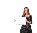 Young lady with blank workbook female keeps big opened on white background Royalty Free Stock Image
