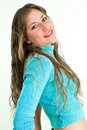 Young lady in blue smiling to camera Royalty Free Stock Image
