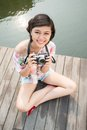 Young lady camera sitting bridge Royalty Free Stock Photography