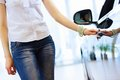Young lady at car salon pretty woman standing near center choosing a Stock Photo
