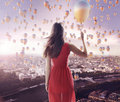 Young lady and the city of the balloons tiny Stock Photography