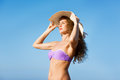 Young lady with curly hair and hat looking far Royalty Free Stock Photo