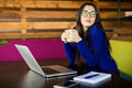 Young lady drink coffee at her working space in modern office. Royalty Free Stock Photo