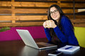 Young lady drink coffee at her working space in modern office Royalty Free Stock Photo