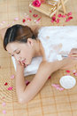 A young lady enjoy body mask in spa salon indoors photo taken on june th Stock Image