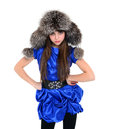 Young lady in fur hat standing hands put on hips blue dress Stock Photo