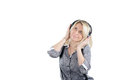 Young lady in a headset enjoying music and rhythm and looking up Royalty Free Stock Photos