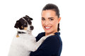 Young lady holding her pet dog white background Stock Photo
