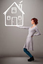 Young lady holding a huge drawn house beautiful Stock Photography