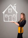 Young lady holding a huge drawn house beautiful Royalty Free Stock Photos