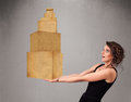 Young lady holding a set of brown cardboard boxes attractive Stock Photography