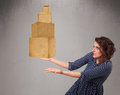 Young lady holding a set of brown cardboard boxes attractive Royalty Free Stock Photos
