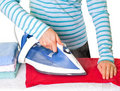 Young lady ironing her clothes Stock Photo