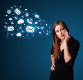 Young lady making phone call with message icons standing and Royalty Free Stock Photo