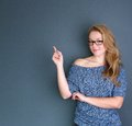 Young lady pointing finger Royalty Free Stock Images