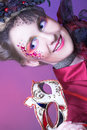 Young lady portrait of charming woman in artistic image posing with mask Stock Image