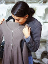 Young lady purchasing clothes in store Royalty Free Stock Image