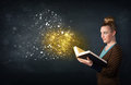 Young lady reading a magical book Royalty Free Stock Photo