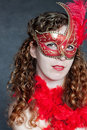Young lady in a red mask Stock Photography