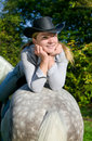 Young Lady riding a horse Royalty Free Stock Image