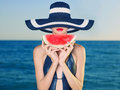 Photo : Young lady at sea with watermelon  back