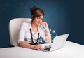 Young lady sitting at desk and typing on laptop with social netw beautiful network icons comming out Stock Photos