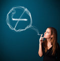 Young lady smoking unhealthy cigarette with no smoking sign pretty unheathy Stock Photos
