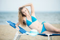 Young lady sunbathing on a beach. Beautiful woman Royalty Free Stock Photo