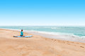 Young lady surfer waiting at a seashore for a big waves to come Royalty Free Stock Photo