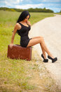 Young lady is waiting any car on the road Royalty Free Stock Photo