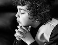 Young latin boy praying latino daily devotional hispanic child and praising god hope in a kid religiuos image Royalty Free Stock Image