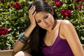 Young Latino Woman in Flower Garden Stock Image