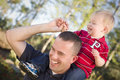 Young Laughing Father and Child Piggy Back Stock Photos