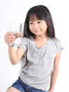 Young little girl drinking water. Royalty Free Stock Photo