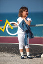Young little girl having fun next to bicycle lane Royalty Free Stock Photo