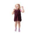 Young little girl jumping over isolated white background with curly hair in purple dress Royalty Free Stock Photo