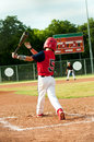 Young little league boy swings bat Royalty Free Stock Photo