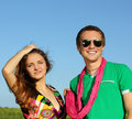 Young love Couple smiling under blue sky Royalty Free Stock Photo