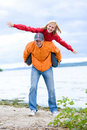 Young love Couple smiling under blue sky. Royalty Free Stock Photography