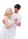 A young and lovely caucasian couple waiting for the baby in white clothes image is isolated on white background Stock Photos