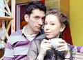 Young lovers couple drinking coffee cafe Royalty Free Stock Image
