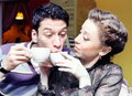 Young lovers drinking coffee cafe funny shot Stock Photography
