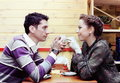 Young lovers drinking coffee cafe romantic shot Stock Photography