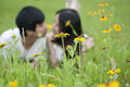 The young lovers frolic in the flowers Stock Image