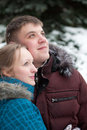 Young lovers woman and man in  winter forest Royalty Free Stock Photo