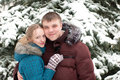 Young lovers woman and man in  winter forest Stock Photos