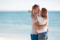 Young loving couple on the beach near the sea Royalty Free Stock Photo