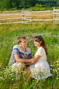 Young loving couple embracing  each other  sitting in the grass Royalty Free Stock Photo