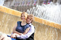 Young loving couple and fountain water jets Royalty Free Stock Image